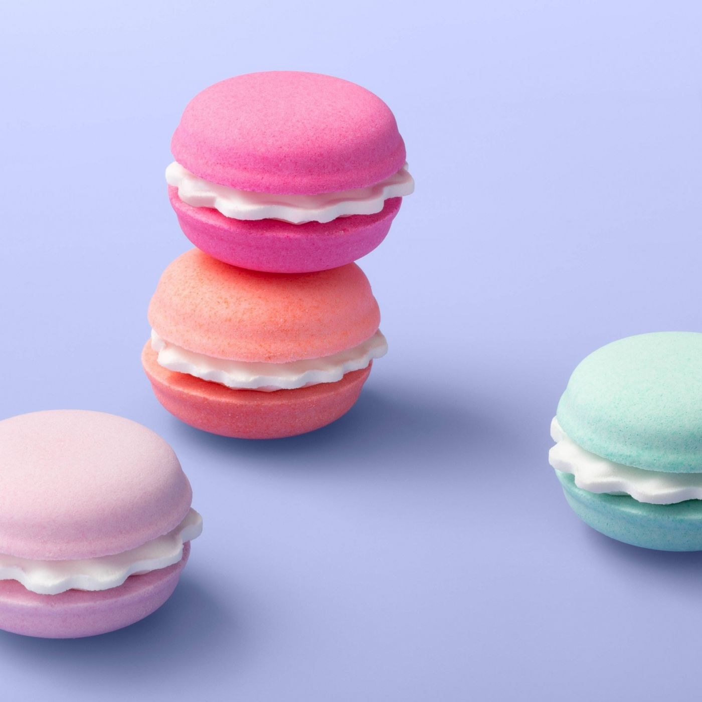 The bath bombs, which are shaped like small, pastel-colored macarons