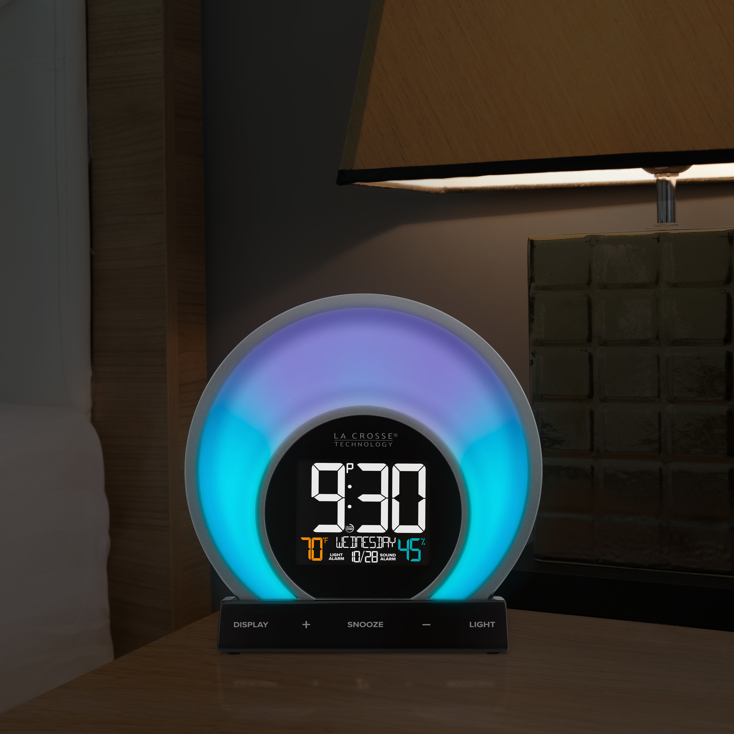 the alarm clock with blue and purple lights