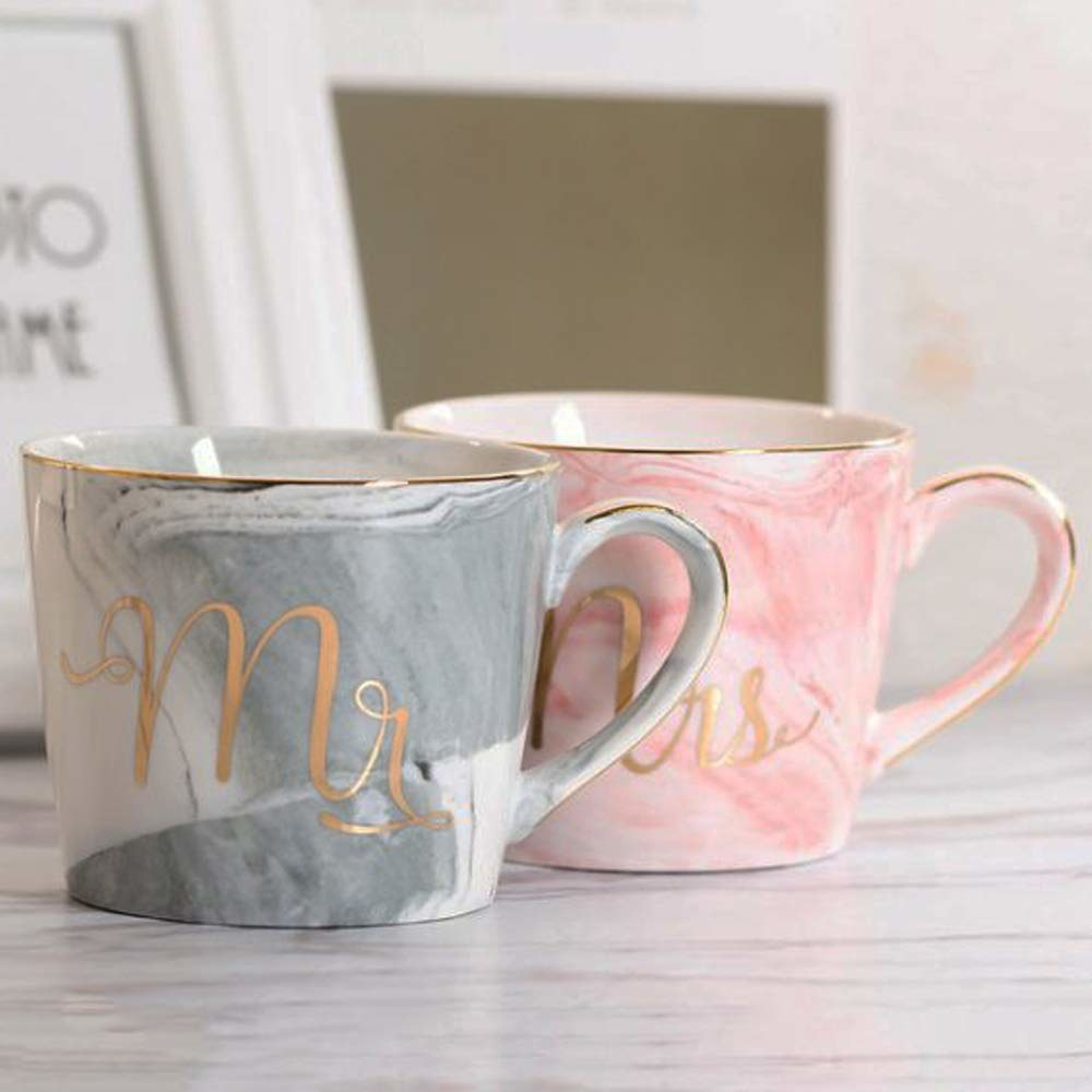 A ceramic mug set in pink and blue