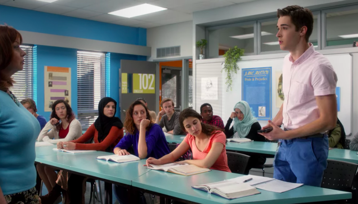 "Miles standing up from his seat in class on ""Degrassi"""