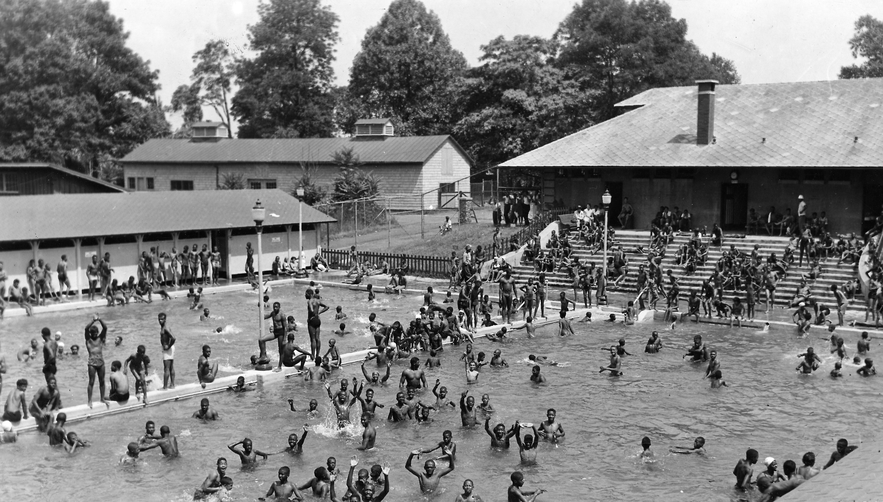 Black children swimming in a segregated pool at Druid Hill Park, Baltimore, Maryland, 1955