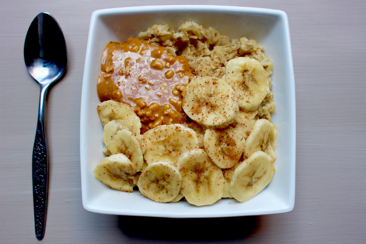 A bowl of overnight oats topped with nut butter and bananas