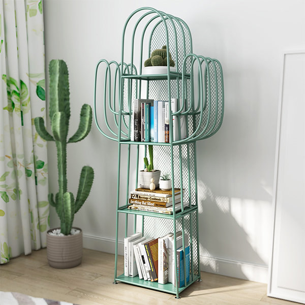 the mint-colored metal cactus bookshelf in a living room with books and plants on it