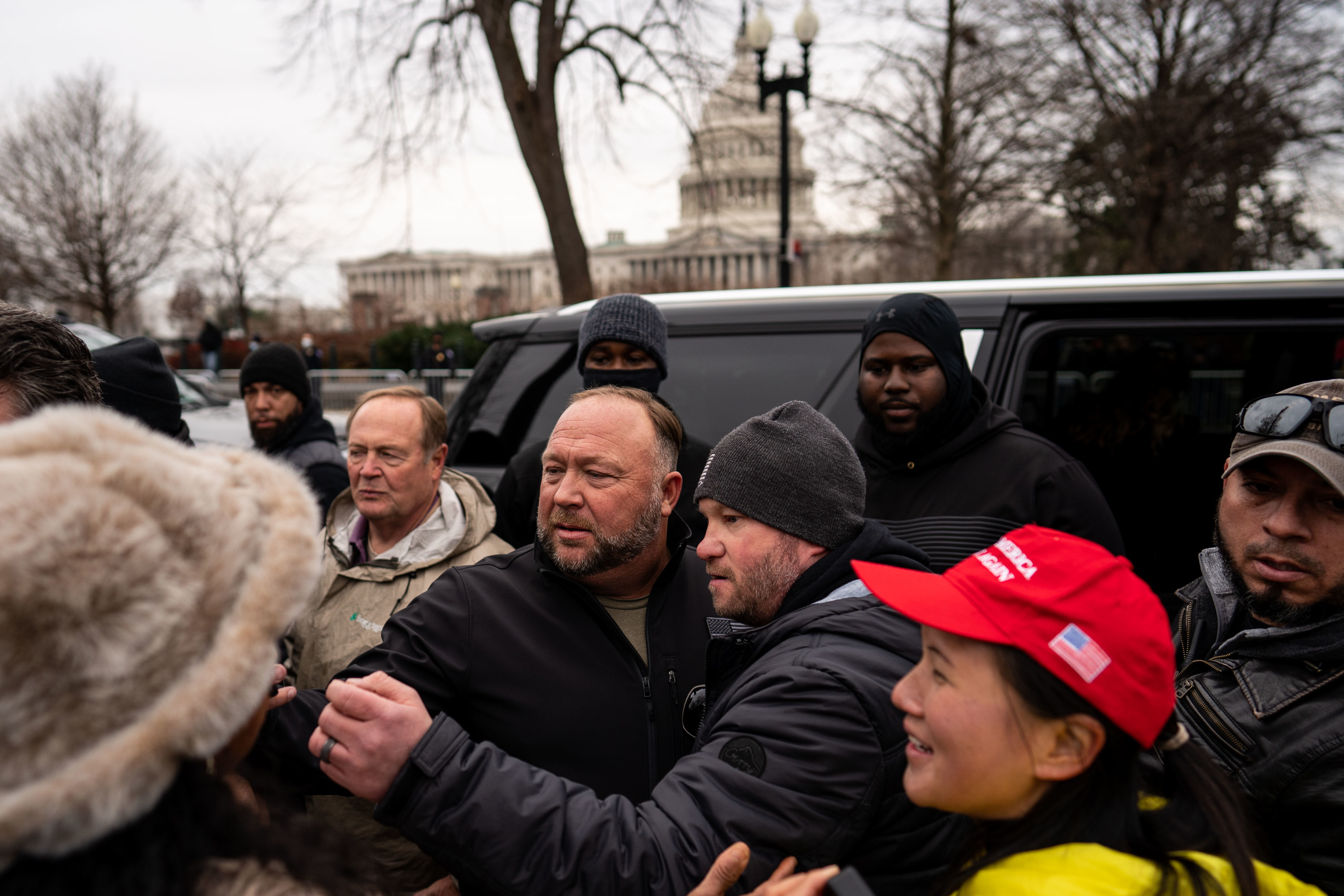 Alex Jones leaves after speaking at a Stop The Steal rally