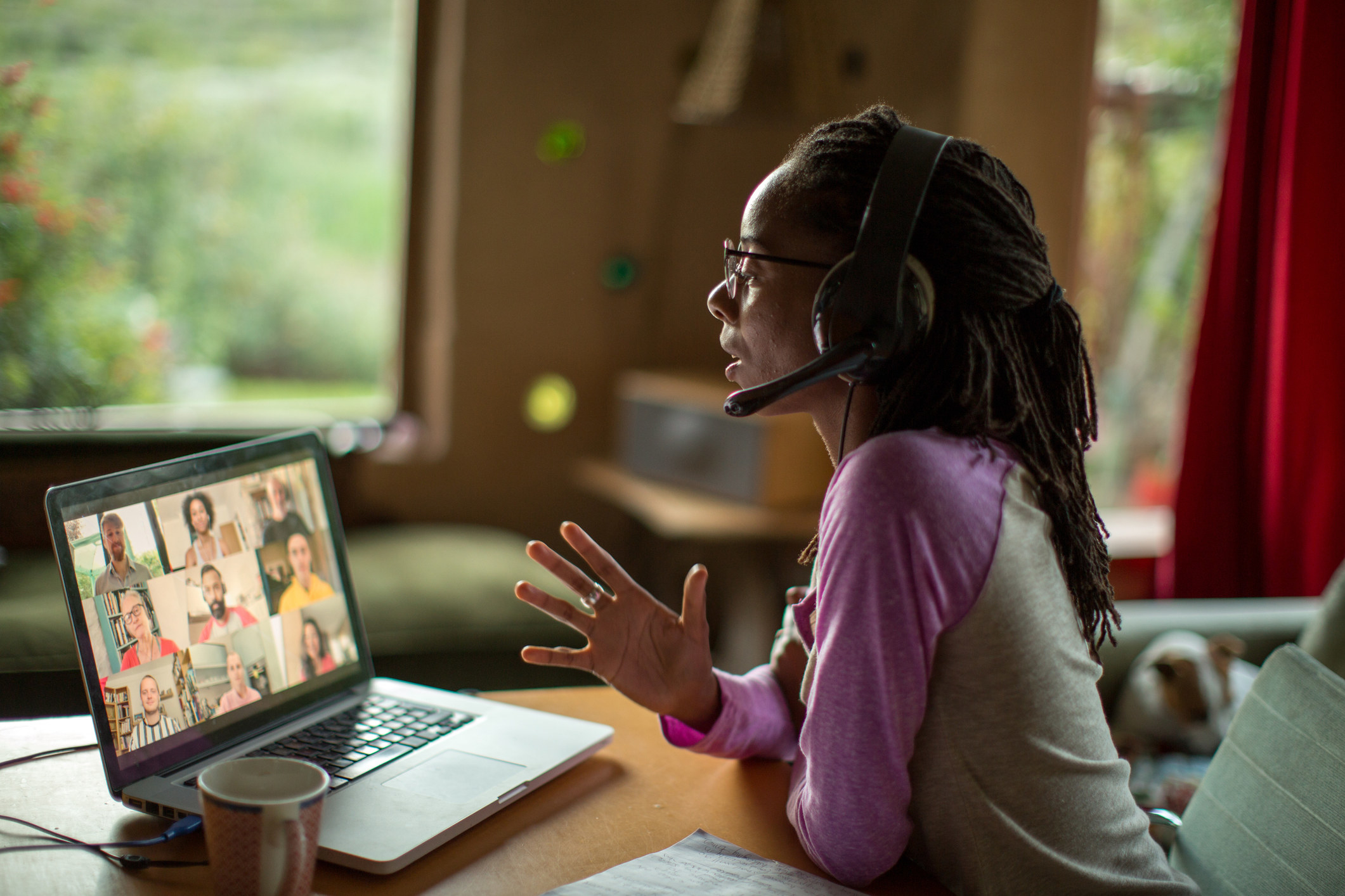 A woman participating in a video meeting