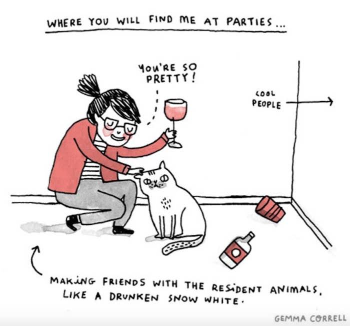 An introvert making friends with a cat at a party.