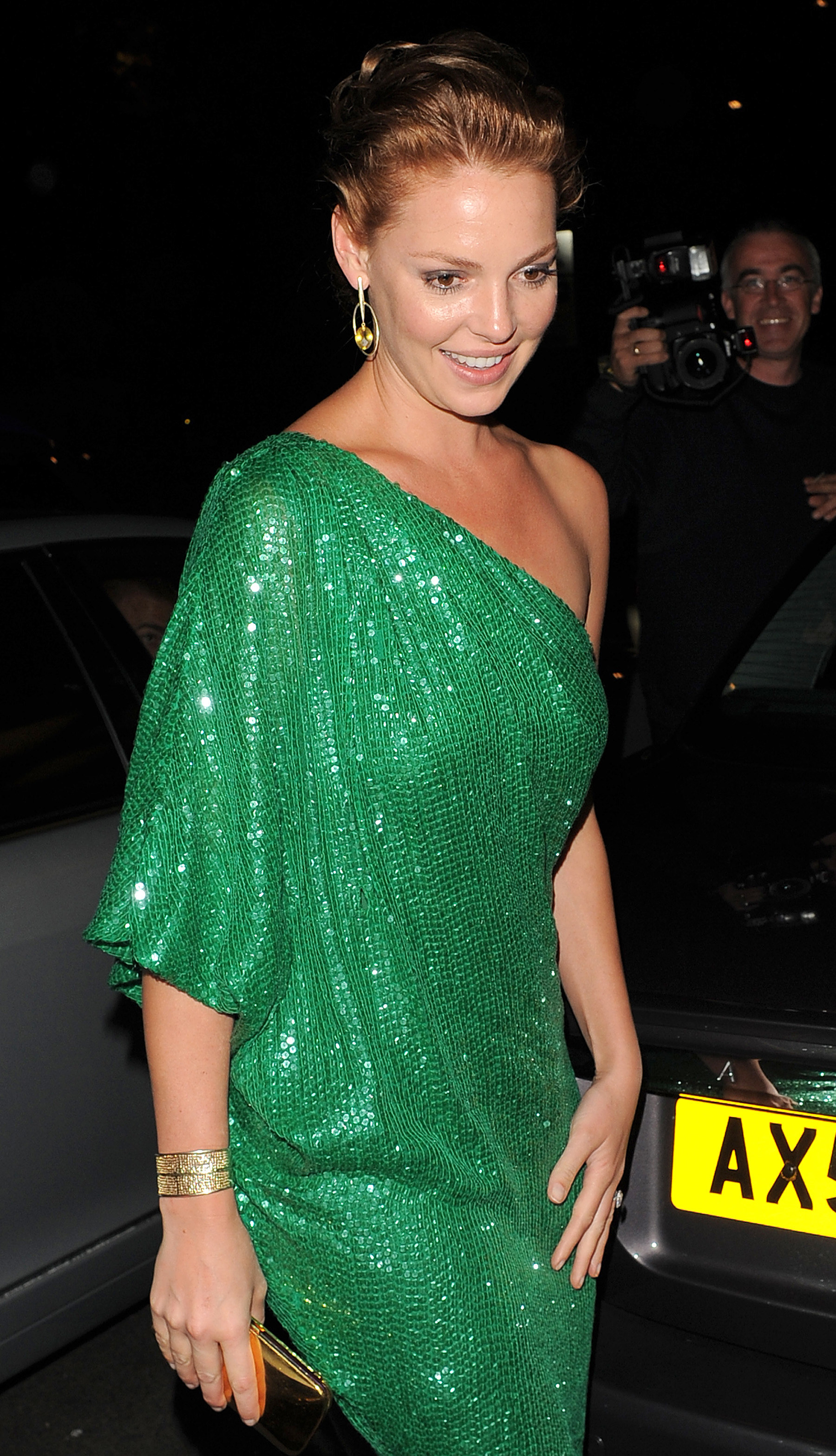 Katherine in a sequined one-shoulder dress