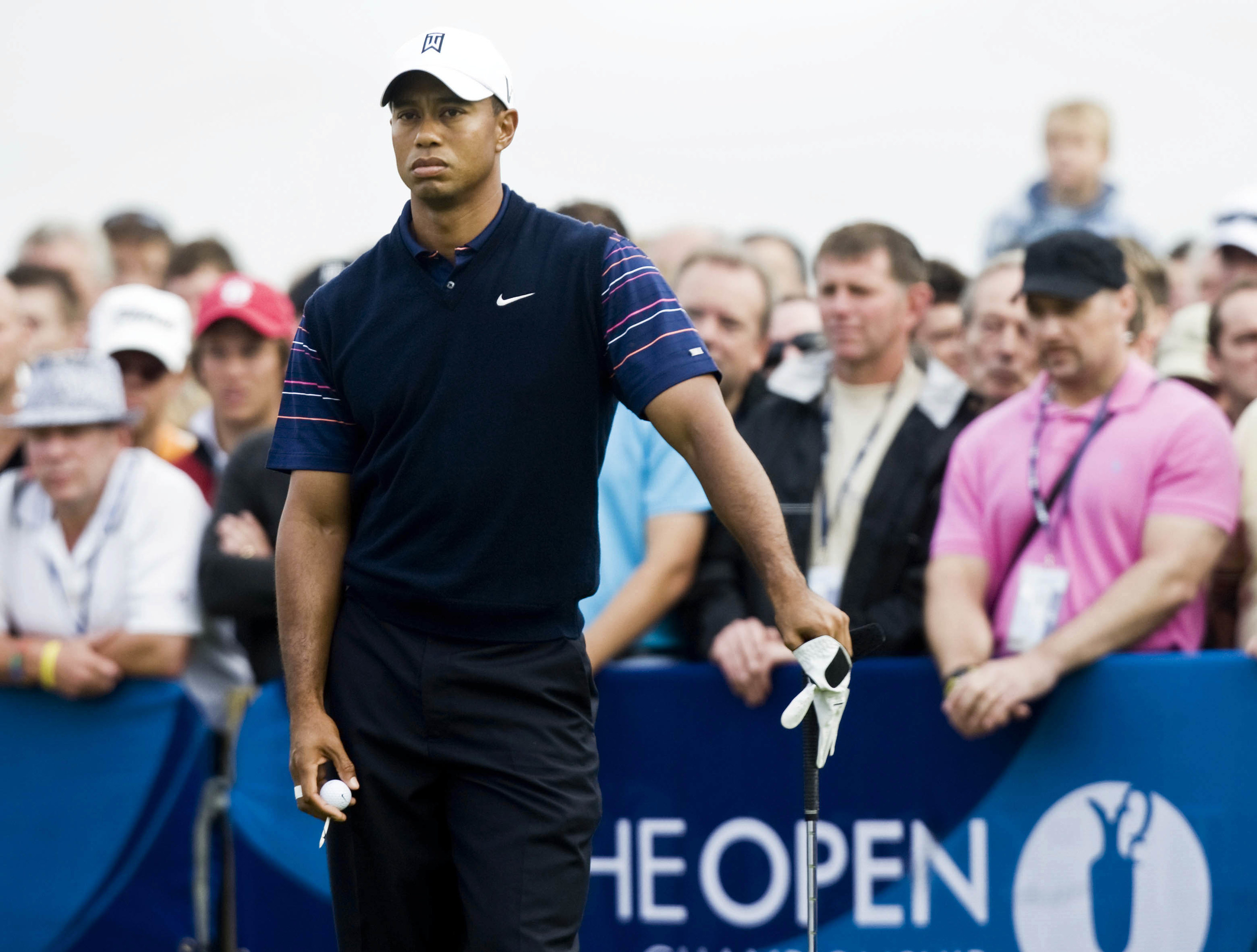 Tiger Woods playing golf as people watch