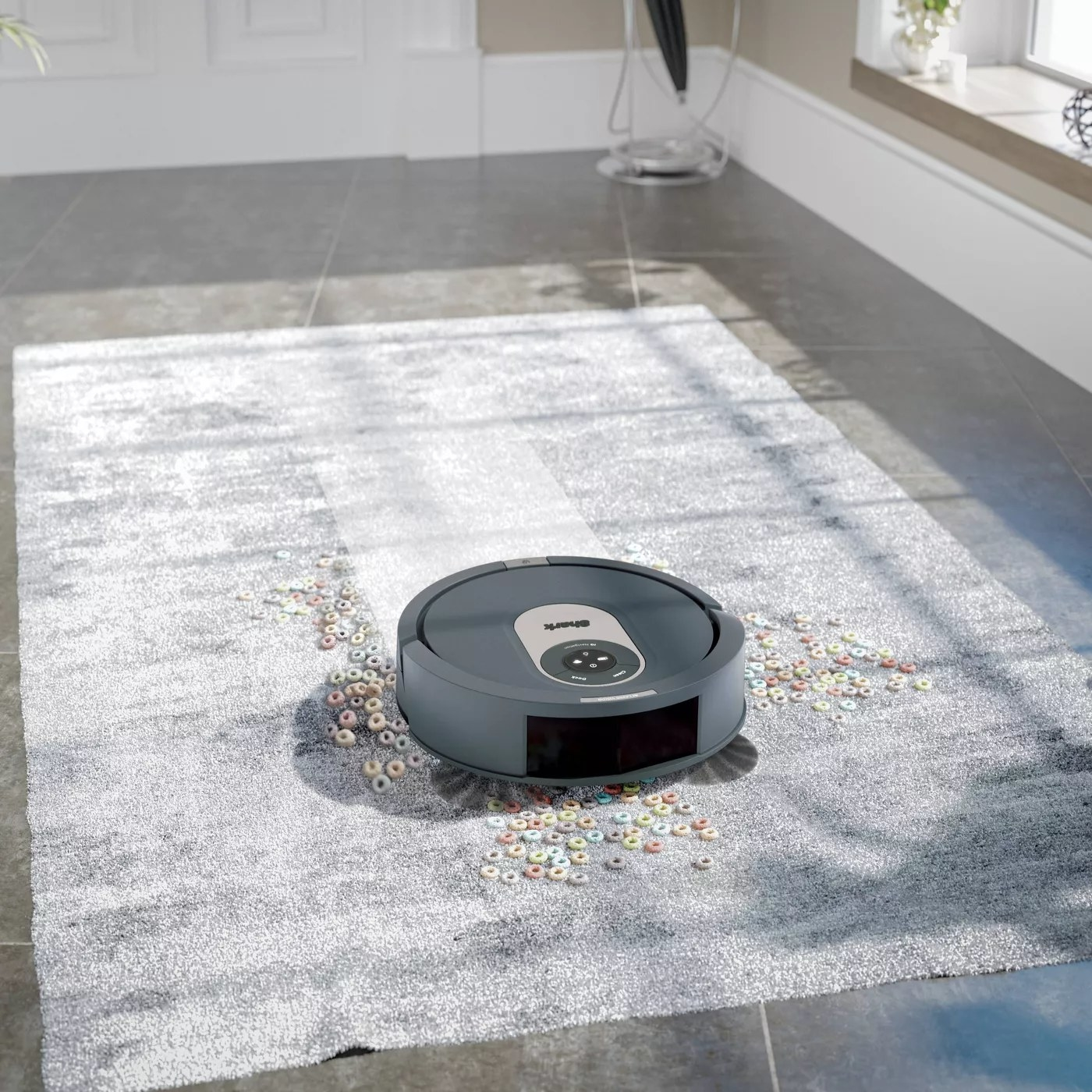 The Shark robot vacuum cleaning up cereal