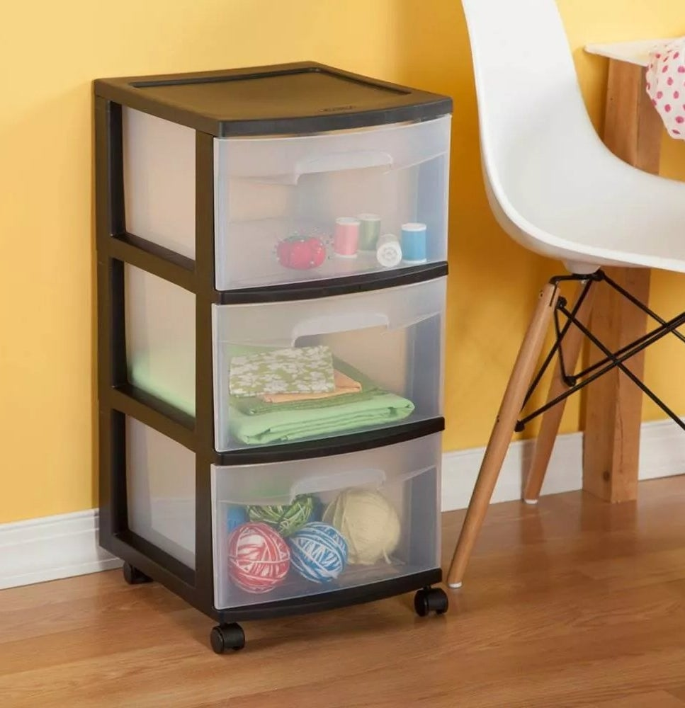 The black rolling storage cart with three clear drawers