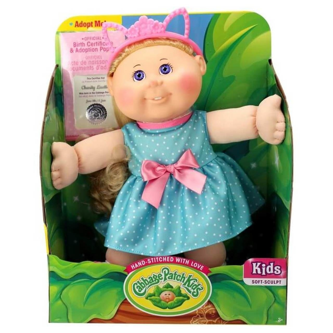 Cabbage Patch Doll still in their box with their hands outstretched