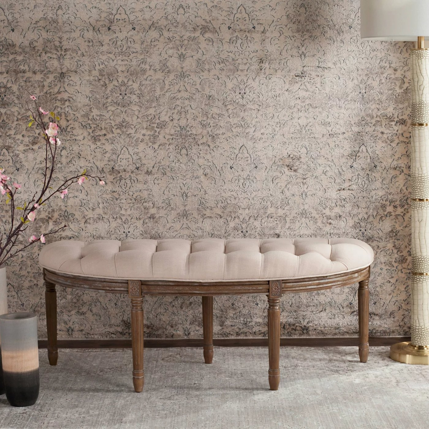 The beige tufted bench