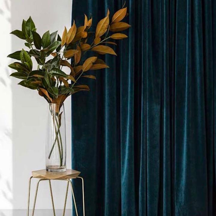 Deep blue velvet curtain behind flower