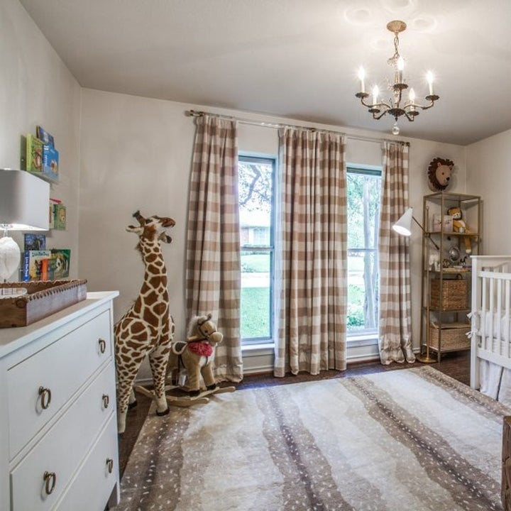 Three brown checkered curtains hanging in nursery