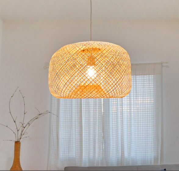 A large bamboo rattan lampshade hung over a dining table