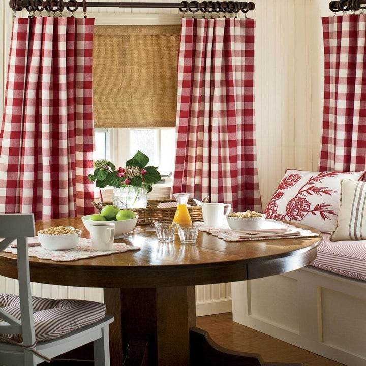 Red checkered panel curtains hanging in dining room