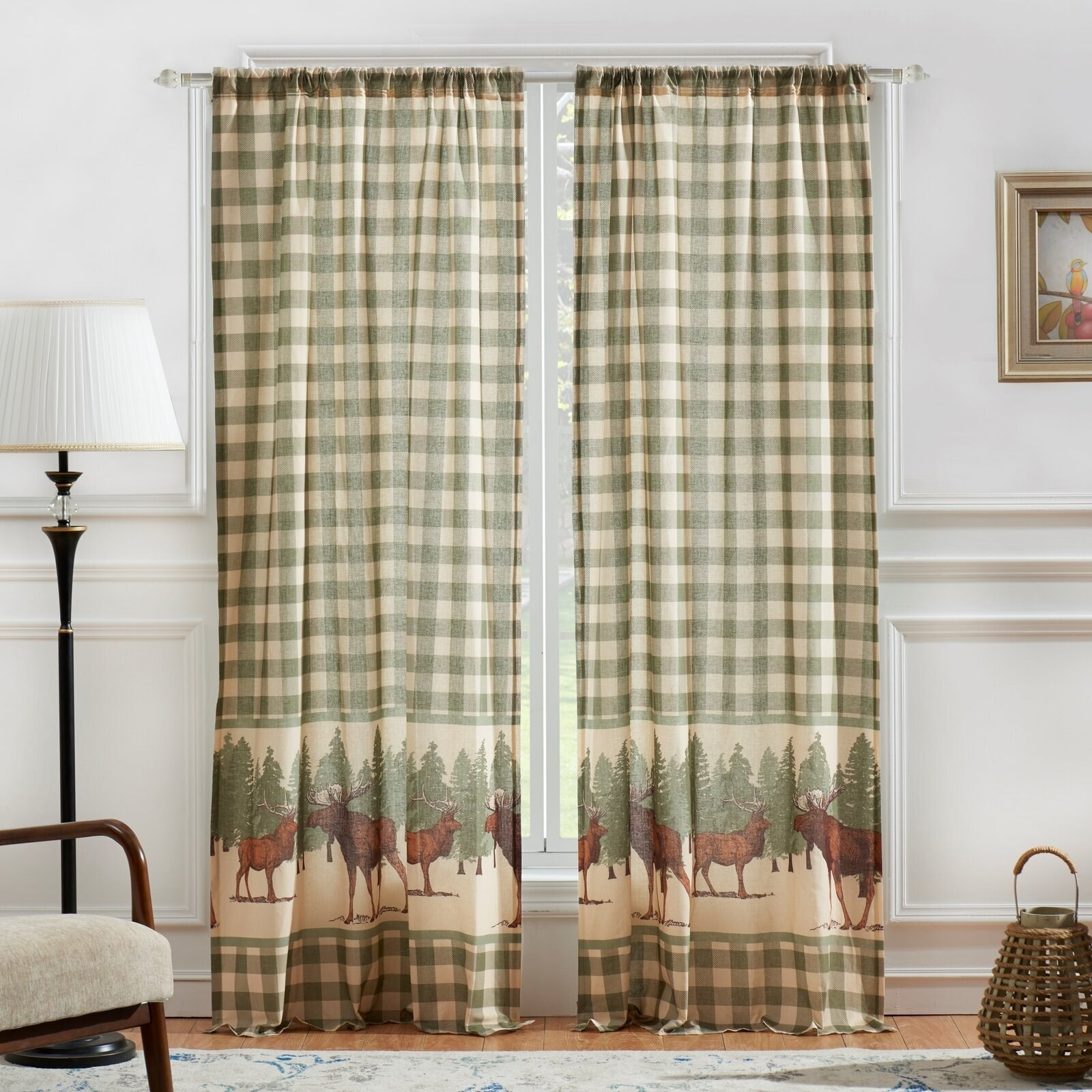 Green checkered floor-length curtains with an image of trees, an elk, and a moose on the bottom