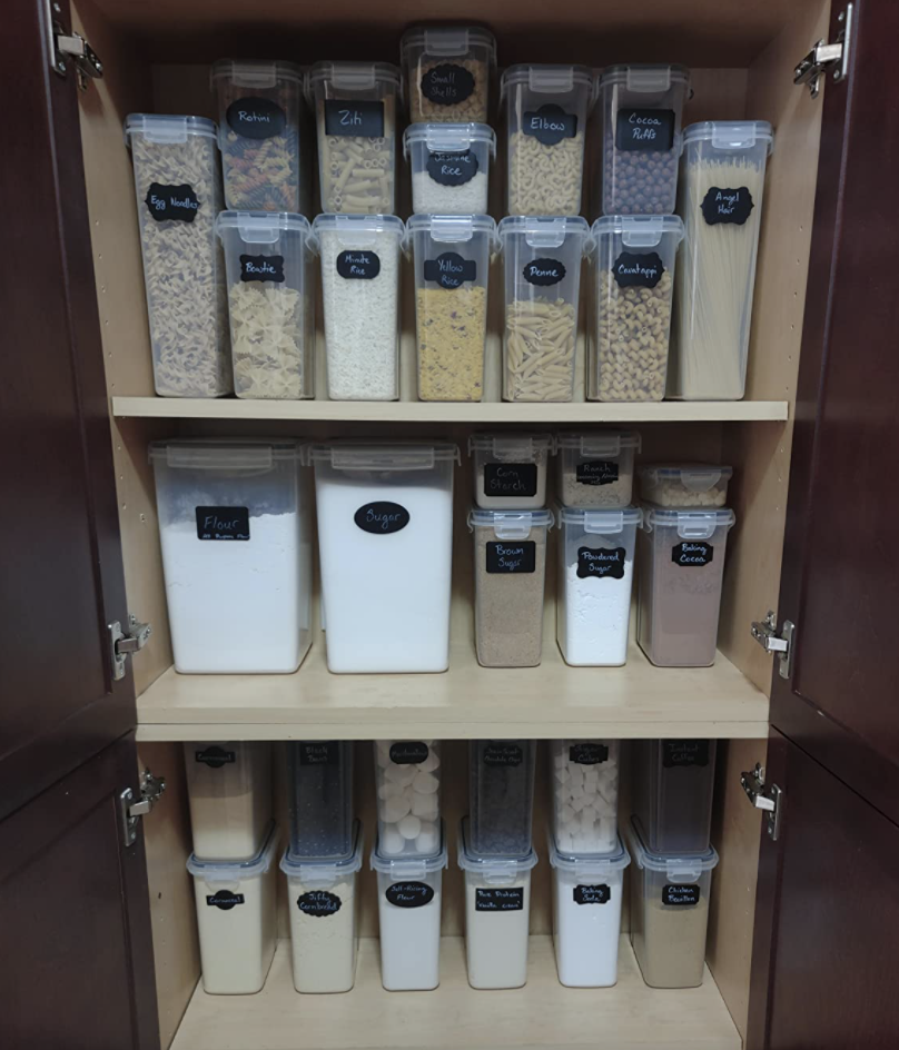 A reviewer's organized pantry with the food storage containers
