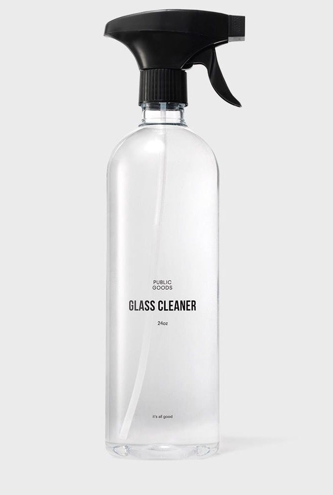 The bottle filled with the clear solution of glass cleaning spray