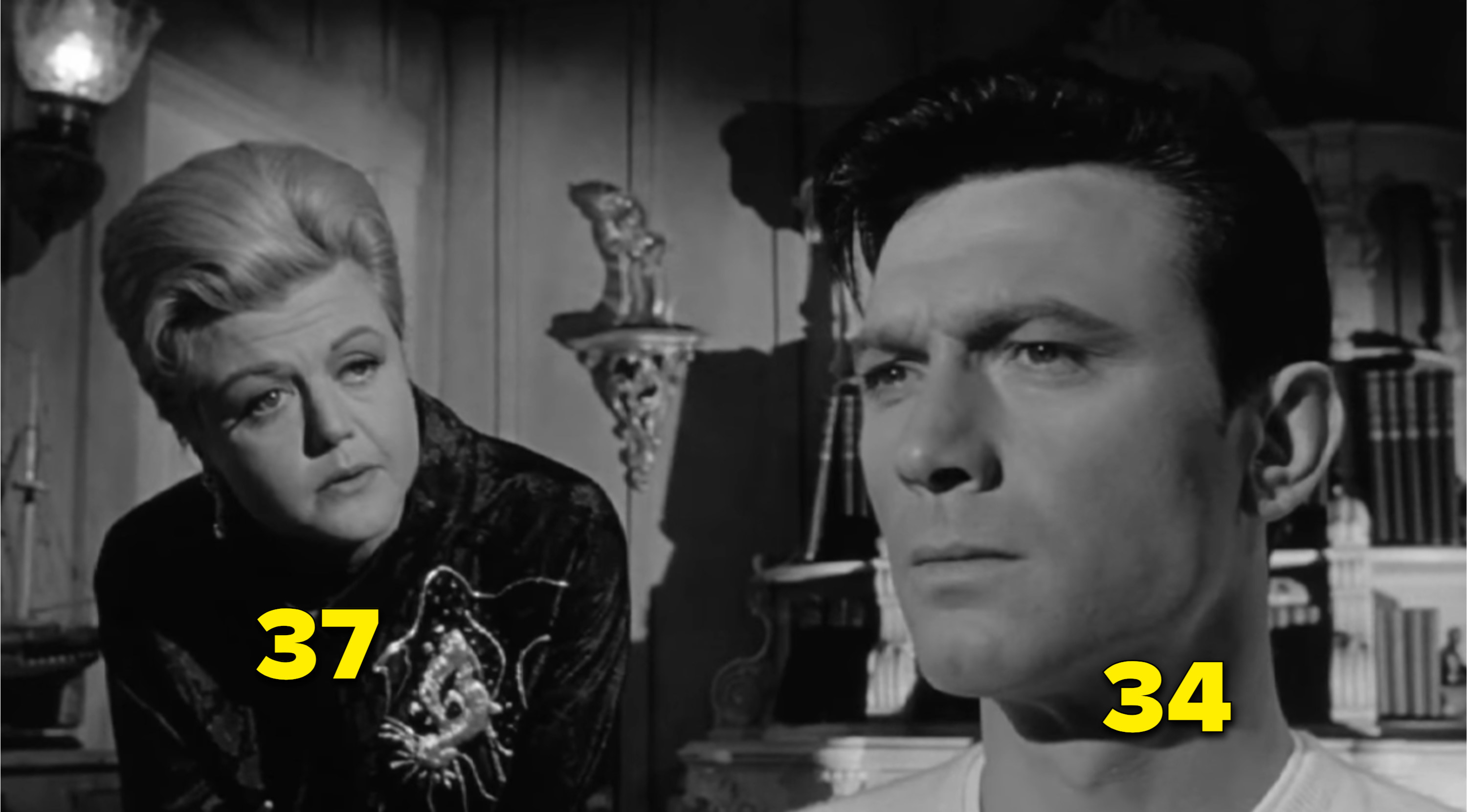 Angela Lansbury talking to Laurence Harvey in a scene