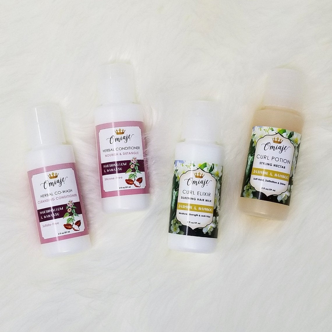 small bottles of herbal cowash, conditioner, curl elixir, and curl potion