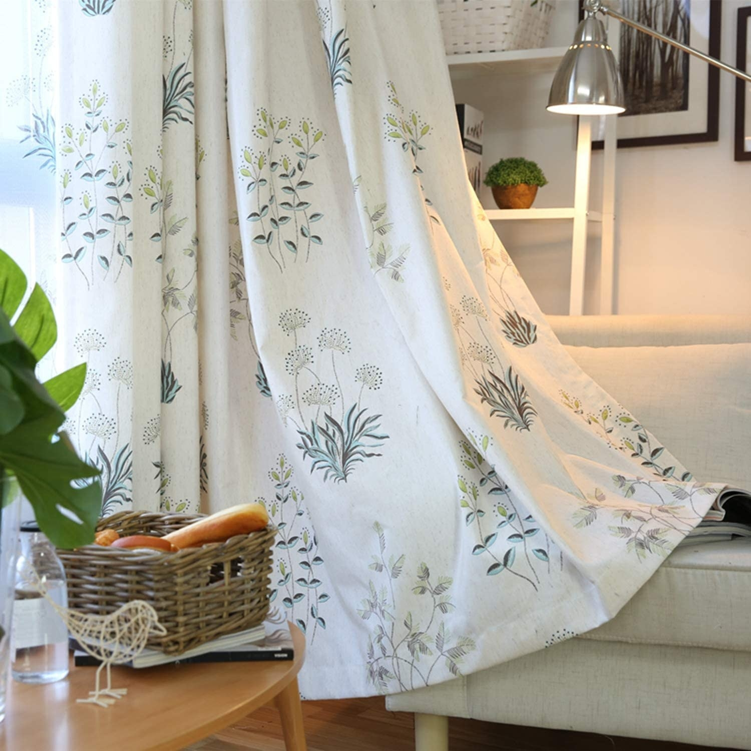 White curtains with subtly colored flowers throughout