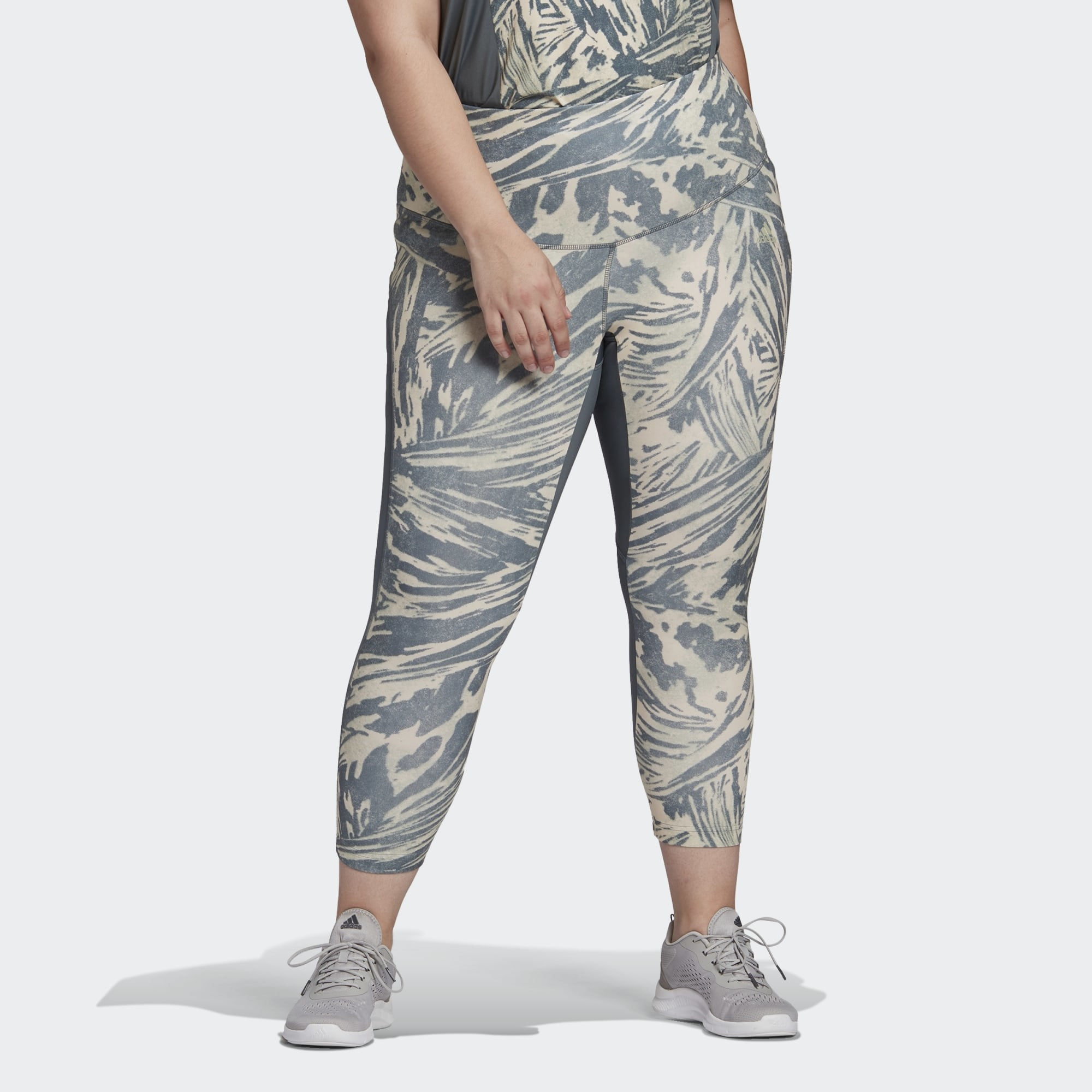 Model wearing pants with white and blue design on them