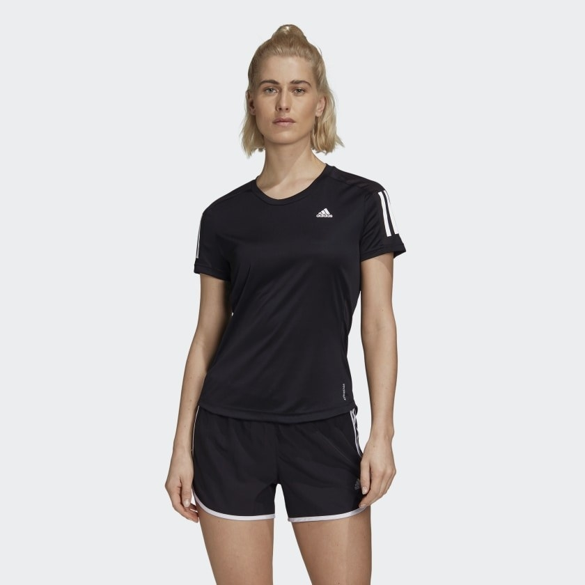a model in a black running tee