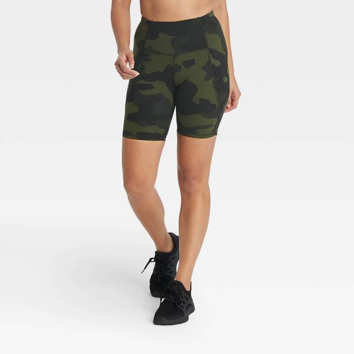 model in camo bike shorts