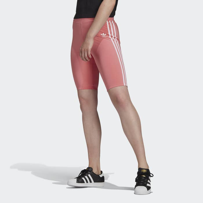 Model wearing pink tight shorts