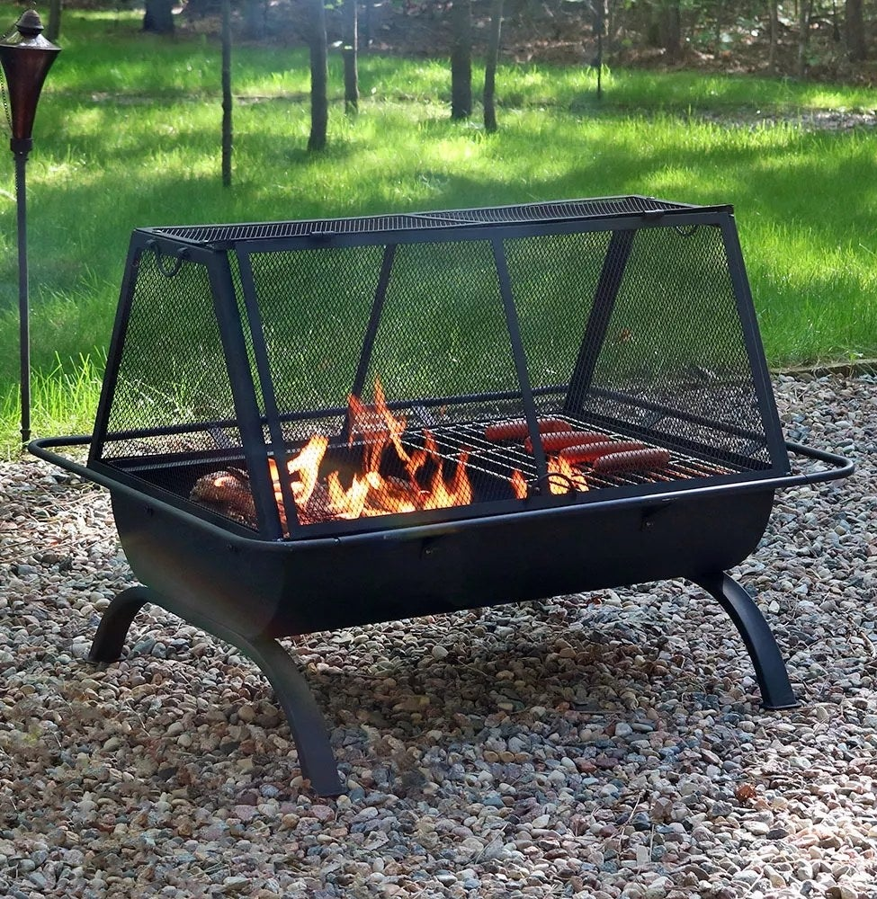 The fire pit with a cooking grate