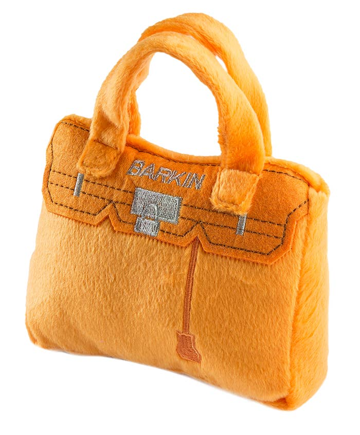 the orange bag which is styled like a Burkin