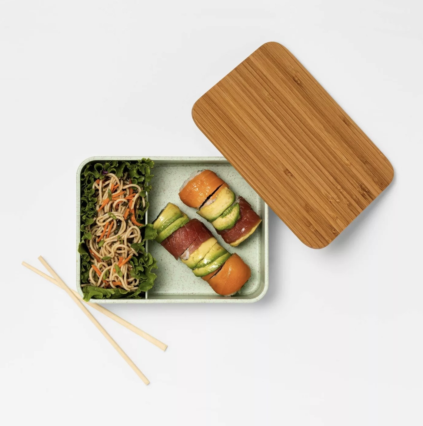 The bento box with sushi and noodles inside