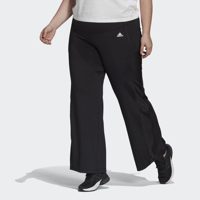 Model wearing black bootcut workout pants