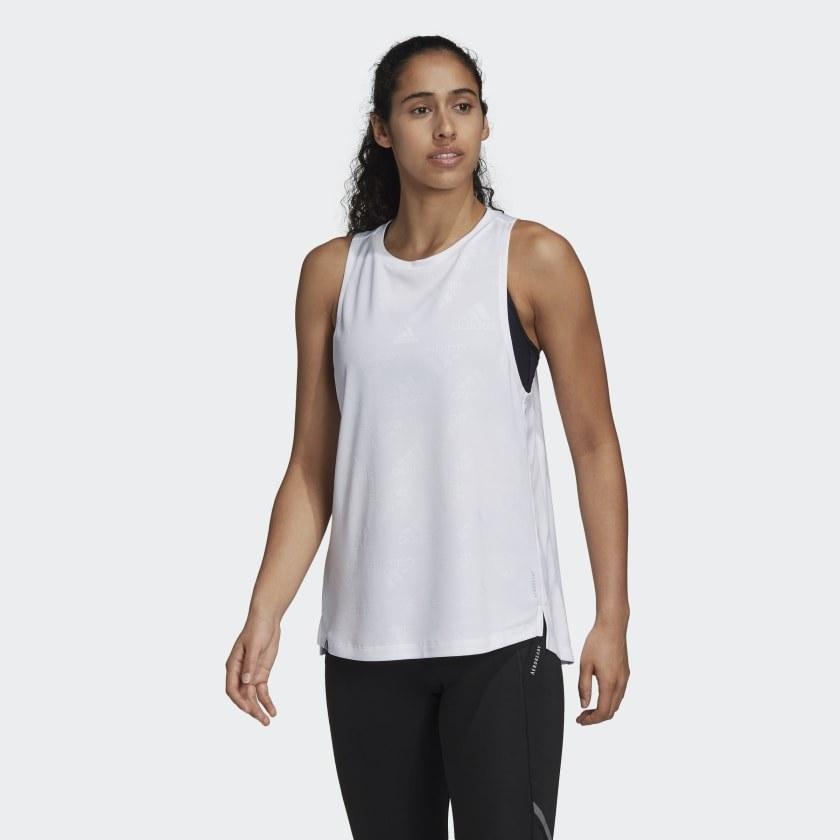 Model wearing white workout tee