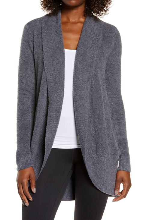 A model wearing the cardigan in Pacific Blue