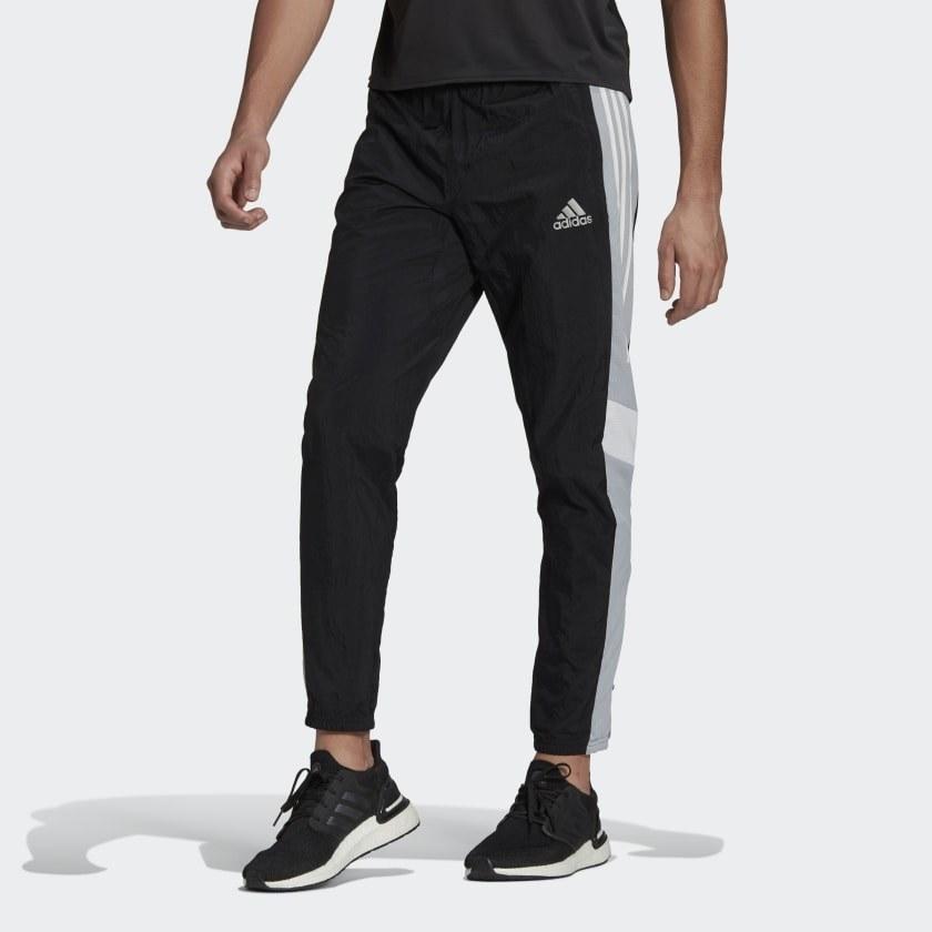 Model wearing track pants