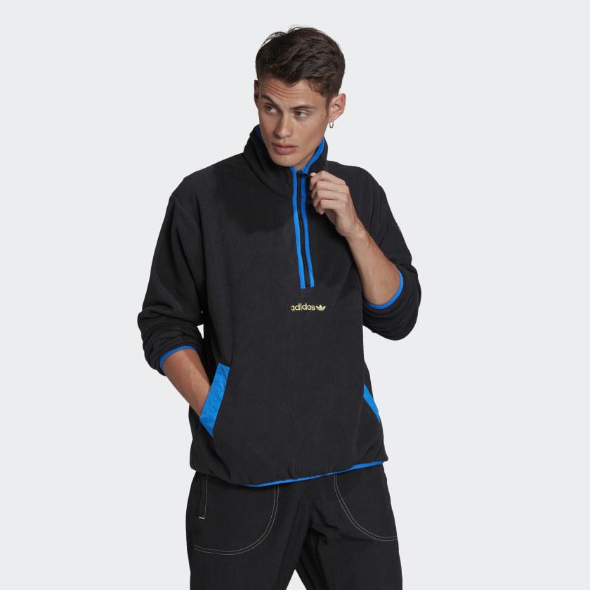Model wearing blue zip up pullover