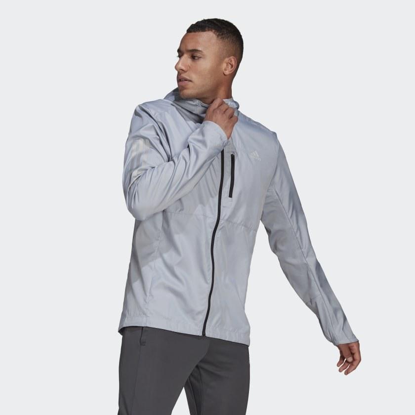 Model wearing silver rain jacket