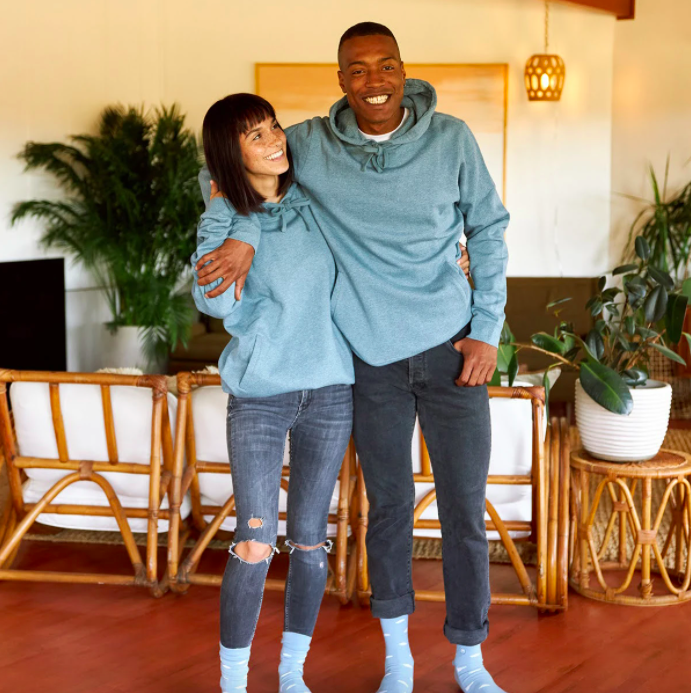 Two models wearing the hoodie
