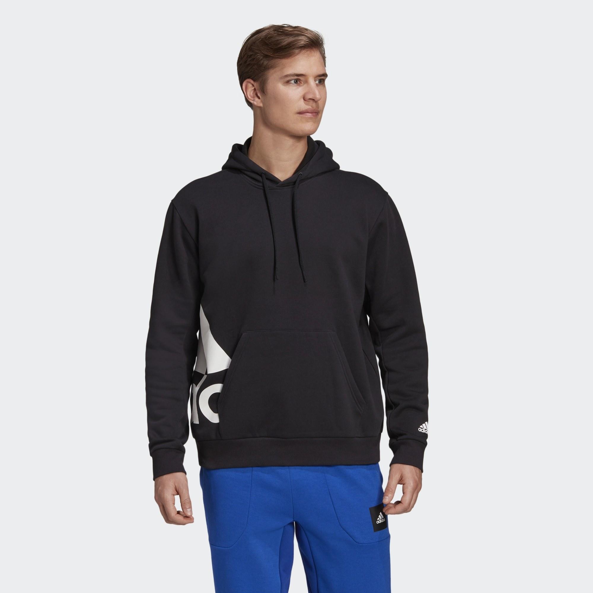Model in black hoodie
