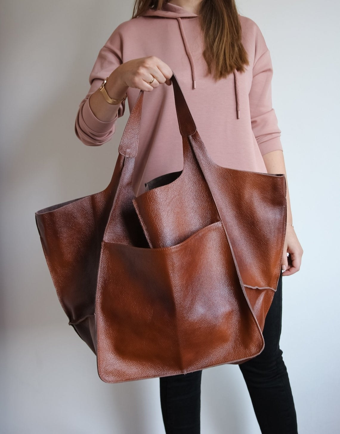 A model holding up the tote bag