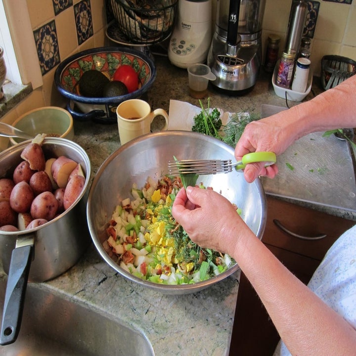 Reviewer using herb scissors to chop fresh herbs