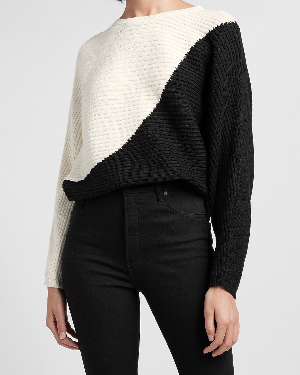model wearing the sweater in white and black