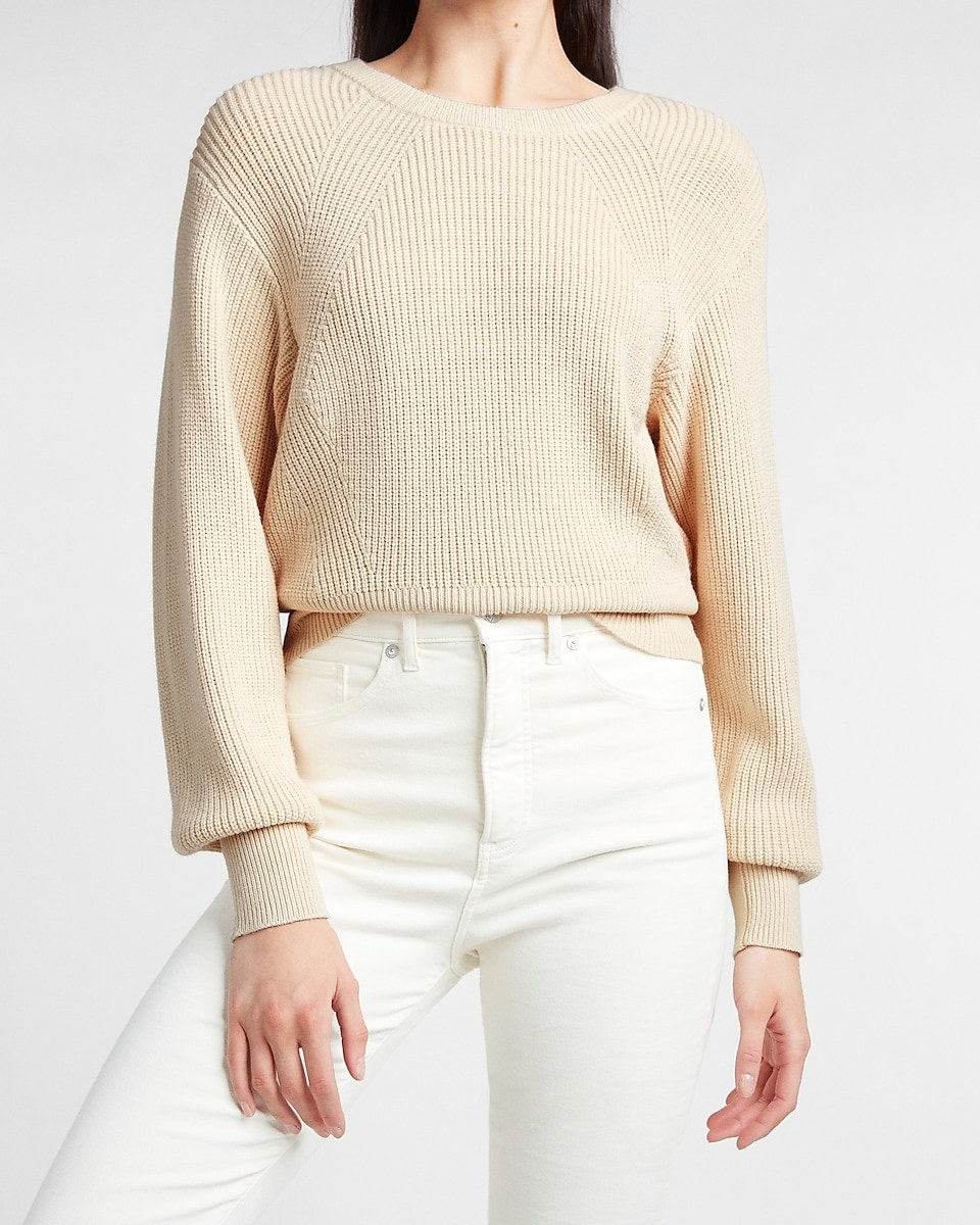 model wearing the ribbed sweater in sandshell