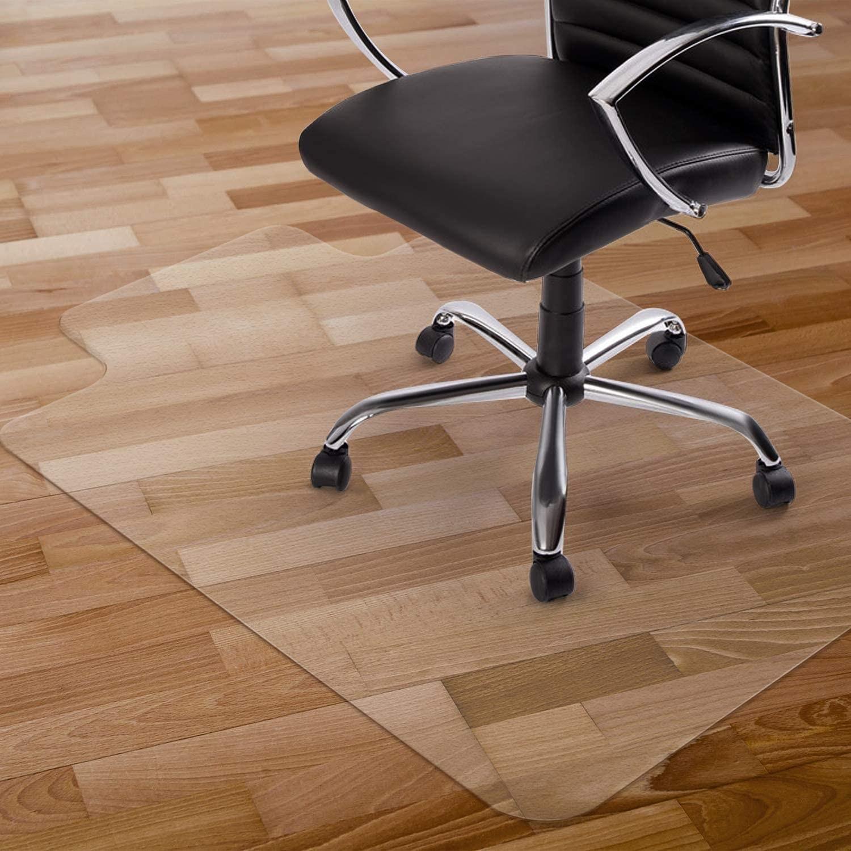 An office chair on a mat on a wooden floor