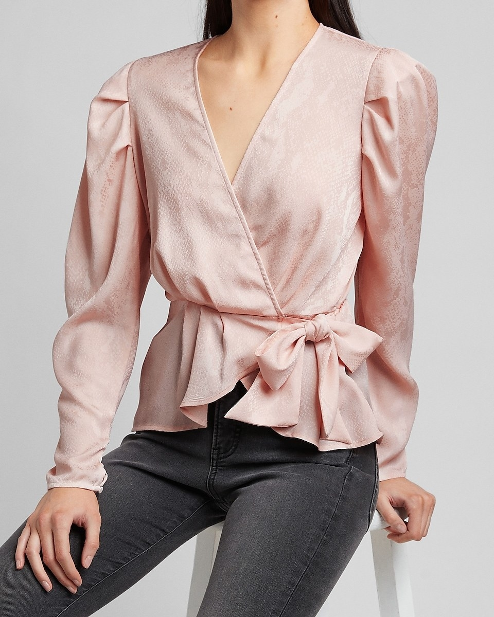 model wearing subtly snake-print wrap top in pale peony