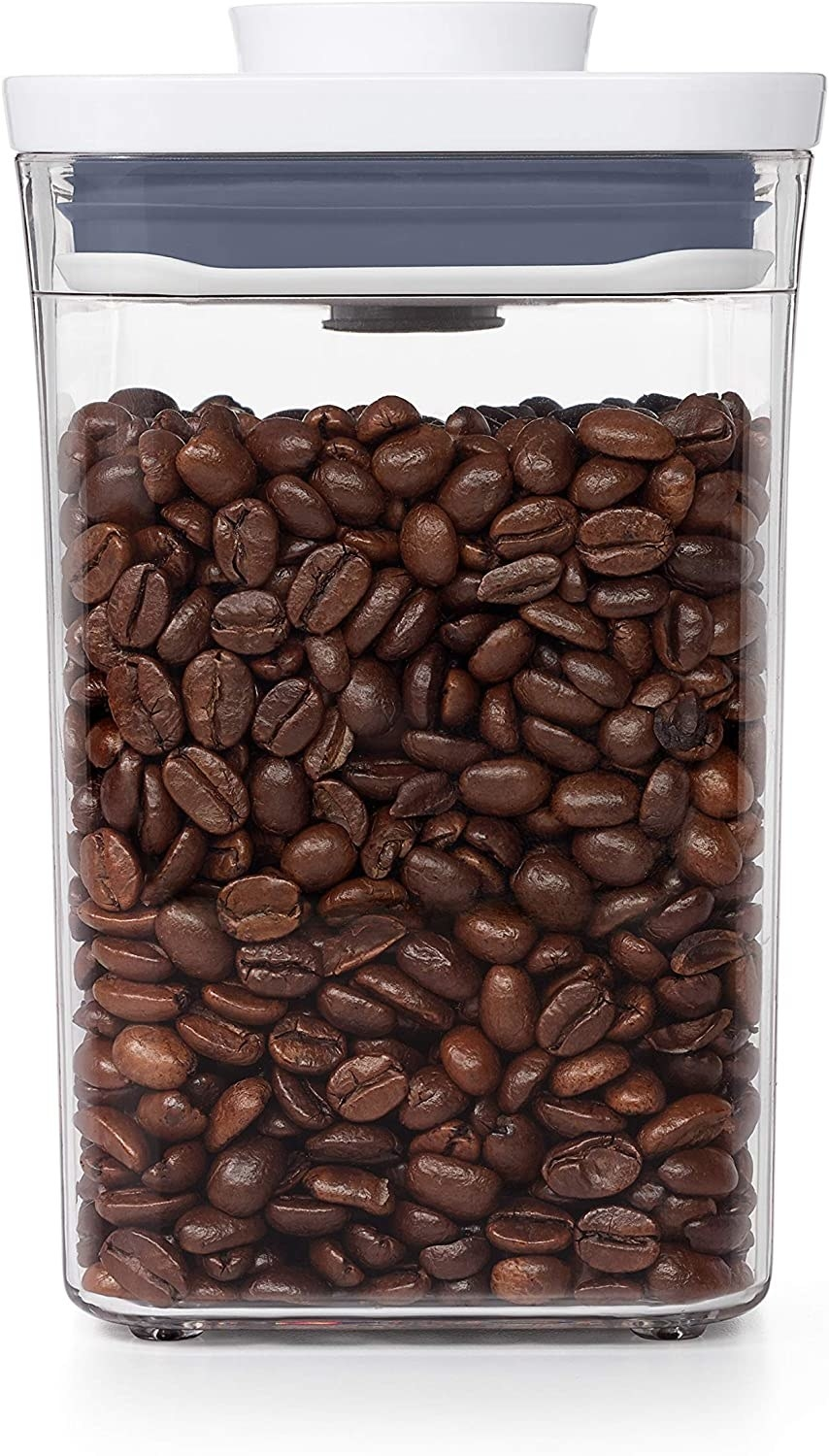 A clear container filled with coffee beans