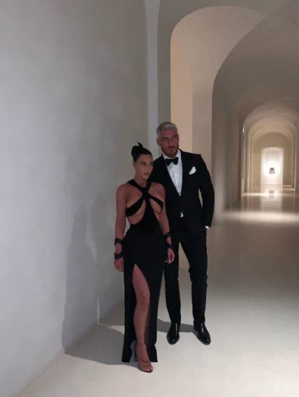 kim and a person in a suit in a place that looks like a abandoned museum