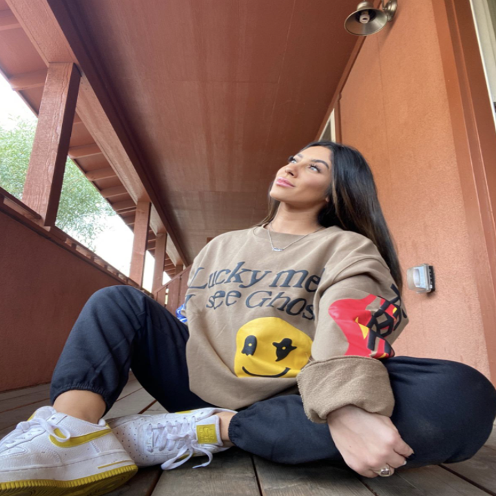 reviewer wearing graphic crewneck